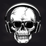 Skull and headphones sketch on blackboard Royalty Free Stock Photography