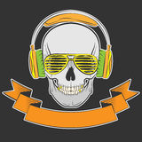 Skull with headphones and sunglasses Royalty Free Stock Image