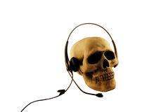 Skull and headset. Skull with headset representing patience over a long chat with help desk or a customer Royalty Free Stock Photography