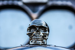 Skull Hood Ornament. Silver skull hood ornament on a top of a restored vintage hot rod at the 3rd Annual Rockabillaque in North Charleston, SC Stock Photography