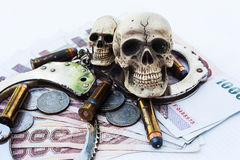 Skull human with handcuff and bullet .375 Stock Photography