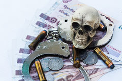 Skull human with handcuff and bullet .375 Royalty Free Stock Photos