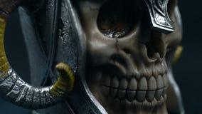 Skull of the human. In metal helmet with horns stock video footage