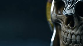 Skull of the human. In metal helmet with horns. close up stock footage