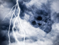 Skull idea of dark clouds with lighting Stock Images
