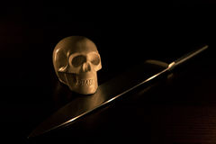 Skull and knife. Halloween background royalty free stock photo