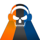 Skull listening music with headphone. Royalty Free Stock Photography