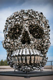 The skull. Skull made of dishes and kitchen utensils. Street art sculpture skimmer cooking pot royalty free stock image