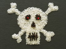 Skull, made of rice and condiments Stock Photo