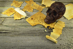 Skull with magic papers Royalty Free Stock Photos