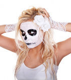 Skull makeup on young girl Stock Images