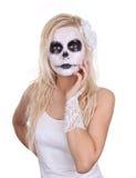 Skull makeup on young girl Stock Image