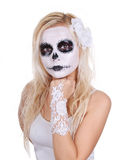 Skull makeup on young girl Stock Photography