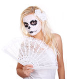Skull makeup on young girl with lace fan Stock Photos