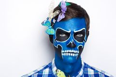 Skull man with butterflies. New creative calavera is a representation of human skull. applied to decorative make up the Mexican celebration of the Day of the royalty free stock photo