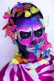 Skull man with butterflies. New creative calavera is a representation of human skull. applied to decorative make up the Mexican celebration of the Day of the royalty free stock photography