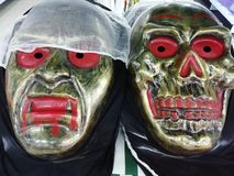 Masks hallowing. Skull mask and horrible man mask stock images