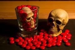 Skull and medicine Royalty Free Stock Photos