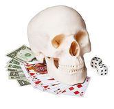 Skull on money and cards. The skull on the money and cards, isolated on a white background Royalty Free Stock Photography