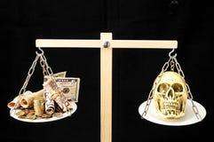Skull and Money Royalty Free Stock Photo