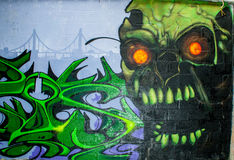 Skull monster graffiti in an abandoned factory building. Royalty Free Stock Photo