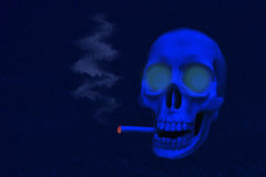 Skull in the night. There is a skull smoking in the picture. The scene is nigthly Stock Photos