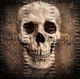 Skull on old sacking Stock Image