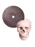 Skull with old saw Royalty Free Stock Photos