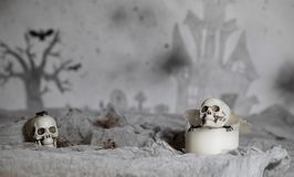 Skull on an old used thick candle. Scary Halloween background. Closeup royalty free stock photos
