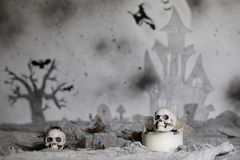 Skull on an old used thick candle. Scary Halloween background. Closeup stock photo