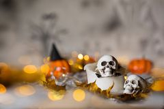 Skull on an old used thick candle. Scary Halloween background. Closeup royalty free stock images