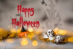 Skull on an old used thick candle. Scary Halloween background. Closeup stock images