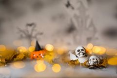 Skull on an old used thick candle. Scary Halloween background. Closeup stock image