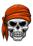Skull in orange bandana Royalty Free Stock Photography