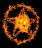 Skull in orange flame pentagram Stock Photography
