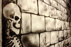 Skull painted on a wall Royalty Free Stock Images