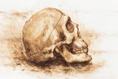 Skull painting on paper. Ochre color skull. Skull painting on paper. Ochre color skull Stock Photo