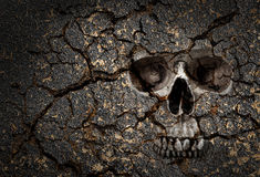 Skull pattern on cracked wall. Human skull pattern on grunge cracked wall Royalty Free Stock Photography