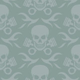 Skull and Pistons Seamless Background. Seamless  background pattern of skulls and crossed pistons with flames Royalty Free Stock Photo