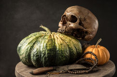 Skull with pumpkin Stock Photo