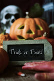 Skull, pumpkins and text trick or treat Stock Images