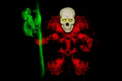 Skull with red smoke on black background,Halloween day.  Royalty Free Stock Photo