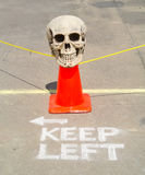 Skull road hazard marker keep left Stock Photo
