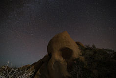 Skull Rock with stars, Joshua Tree National Park Stock Photo