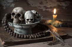 Skull and rosary in offering dish Stock Photo