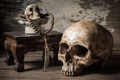 Skull and rosary Stock Image