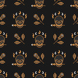 Skull and roses seamless pattern Art Deco Vector background. Seamless pattern Art Deco. Elegant gold skull and roses on a dark background in the style of a thin Royalty Free Stock Photo