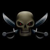 Skull with sabers in dark Stock Photography