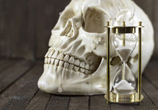 Skull with sand clock Stock Photo
