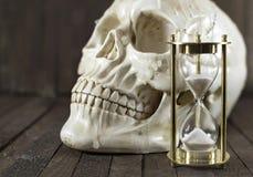 Skull with sand clock Stock Photo